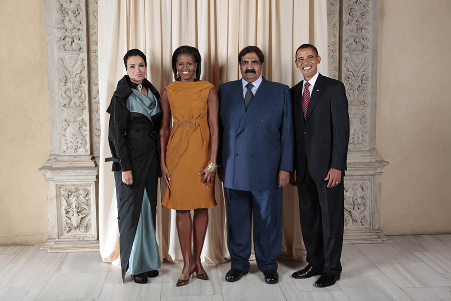 President Barack Obama and First Lady Michelle Obama pose for a photo during a reception at the Metropolitan Museum in New York with, His Highness Sheikh Hamad Bin Khalifa Al-Thani Emir of the State of Qatar and H.H. Sheikha Mozah Consort of H.H. The Emir of the State of Qatar, Wednesday, Sept. 23, 2009. (Official White House Photo by Lawrence Jackson) This official White House photograph is being made available only for publication by news organizations and/or for personal use printing by the subject(s) of the photograph. The photograph may not be manipulated in any way and may not be used in commercial or political materials, advertisements, emails, products, or promotions that in any way suggests approval or endorsement of the President, the First Family, or the White House.
