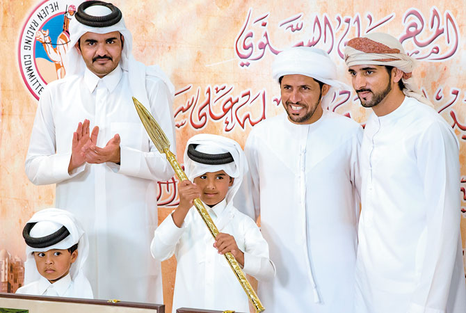 Emir's sons at annual camel racing