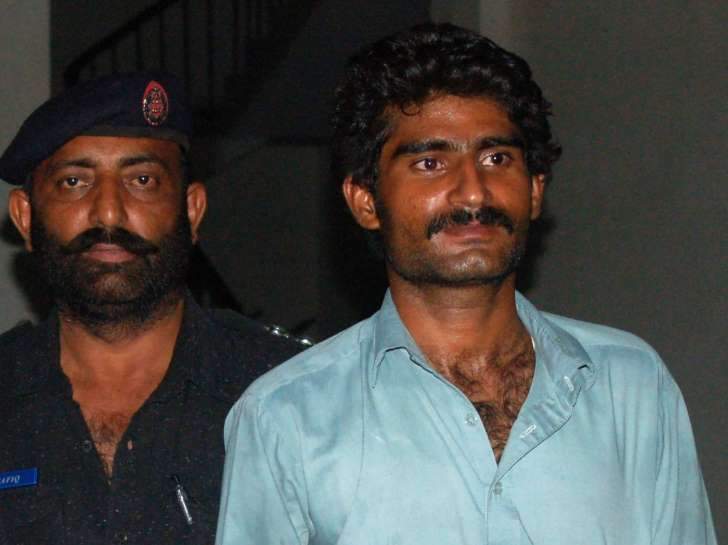 © Provided by AFP Waseem (R), brother of Qandeel Baloch, a social media celebrity, is escorted by police after arrest in Multan on July 16, 2016