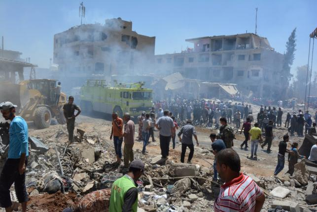 Truck bomb blast kills dozens in northeast Syria city