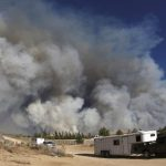 Orders 82,000 people to evacuate over wildfire
