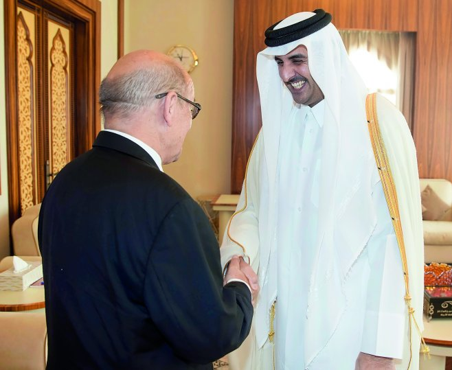 Emir H H Sheikh Tamim bin Hamad Al Thani with French Minister for Europe and Foreign Affairs Jean-Yves Le Drian at Al Bahr Palace yesterday