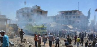 Truck bomb blast kills dozens in northeast Syria city