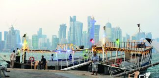 Dhow workers waiting for customers on the Corniche